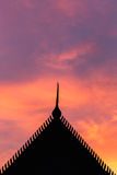 Silhouette Thai style temple roof and sunset Royalty Free Stock Photography