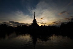Silhouette of Thai temple during sunset with the elegance mood Stock Photos