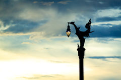 Silhouette Thai traditional beautiful swan lamp on street at twi Royalty Free Stock Images