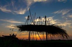Silhouette thatch tripod Stock Photo
