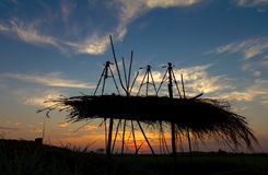 Silhouette thatch tripod Stock Images