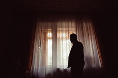 Silhouette of thoughtful man in jacket Royalty Free Stock Image