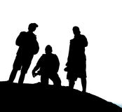 Silhouette of three active men Stock Images