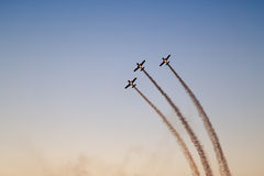 Silhouette of three airplanes performing flight Stock Images