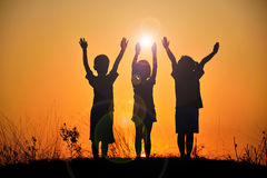 The silhouette of three children royalty free stock images