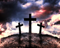 Silhouette of three crosses on a hill Stock Image