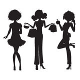 Silhouette of three cute fashion girls Royalty Free Stock Photos