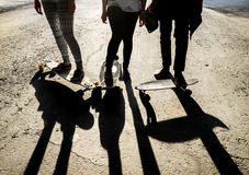 Silhouette three friends skateboarders in city Stock Photography