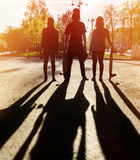 Silhouette three friends skateboarders in city Stock Photo