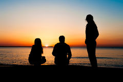 Silhouette of three friends at sunrise Royalty Free Stock Photos