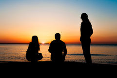 Silhouette of three friends at sunrise Stock Photography