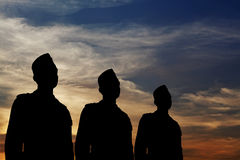 Silhouette of a three man parade. Stock Images