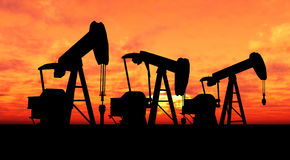 Silhouette three oil pumps Royalty Free Stock Photography