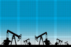 Silhouette of three oil pumps at blue background. Royalty Free Stock Image