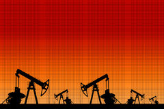 Silhouette of three oil pumps at orange background. Stock Images