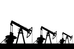 Silhouette of three oil pumps. Stock Photo