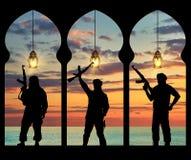 Silhouette of three terrorists Stock Photos