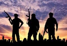 Silhouette of three terrorists Royalty Free Stock Photos