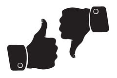 Silhouette of thumb up and thumb down symbols of like and dislike Royalty Free Stock Images