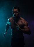 Silhouette Topless Athletic Man in a Fighting Pose Royalty Free Stock Images
