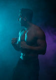 Silhouette Topless Athletic Man in a Fighting Pose Royalty Free Stock Photography