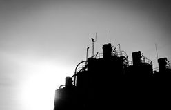 Silhouette tops silos Stock Image