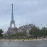 Silhouette of Tour Eiffel through the window with rain drops stock photo