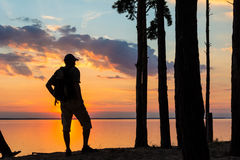 Silhouette of tourist and a beautiful landscape Stock Image