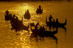 Silhouette of Tourist Boats at U bein bridge Stock Photo