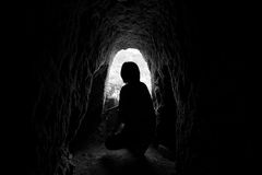 Silhouette of tourist in old mining tunnel. At Pilok, Thong Pha Phum, Kanchanaburi, Thailand. Black and white Royalty Free Stock Photos