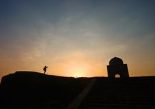 Silhouette of a tourist taking photo of a tomb Royalty Free Stock Photography