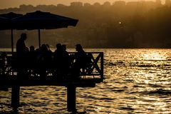 Silhouette of Tourists at Bosphorus Stock Images