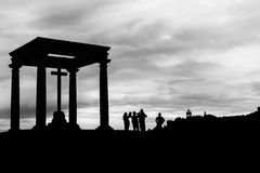 Silhouette of tourists at the Four Columns in Avila Royalty Free Stock Image