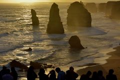 Silhouette of Tourists looking at the Twelve Apostles in Victoria Australia. Silhouette of Tourists looking at the Twelve Apostles Great Ocean Road in Victoria stock images