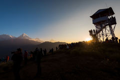 Silhouette tourists meet the sunrise at top of Poonhill 3,210m ,Nepal. Royalty Free Stock Photography