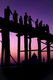 The silhouette of the tourists walking over the wooden bridge in Mandalay, Myanmar Stock Image