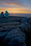 Silhouette of Tourists Watching Sunrise at Cadillac Mountain in Royalty Free Stock Photos
