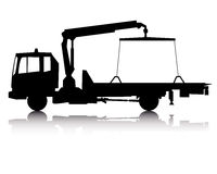 Silhouette of a tow truck. Black silhouette of a tow truck on a white background Stock Images