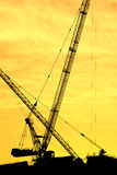 Silhouette of the tower crane Royalty Free Stock Image