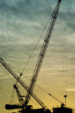 Silhouette of the tower crane Stock Image