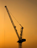 Silhouette of tower crane for construction site at sunset Royalty Free Stock Photo