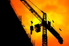 Silhouette Tower crane construction work on sunset-sunrise time background and copy space add text.  royalty free stock images