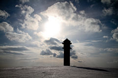 Silhouette of tower on mountain in winter Stock Photo