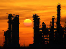 Silhouette tower of oil refinery Stock Photos
