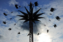 Silhouette of Towering Carnival Swing Ride Stock Photos