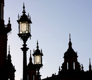 Silhouette of towers and lanterns, Seville, Spain Stock Photo