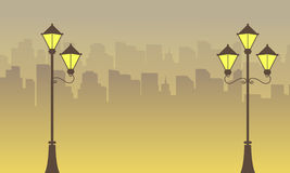 Silhouette of town and street lamp scenery. Vector art royalty free illustration