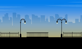 Silhouette of town with street lamp scenery. Vector art stock illustration