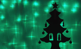 Silhouette of a toy Christmas tree. Holiday background: silhouette of a toy Christmas tree Stock Photography
