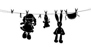 Silhouette toys drying on rope after washing Stock Photography